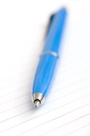 blue pen on white notebook