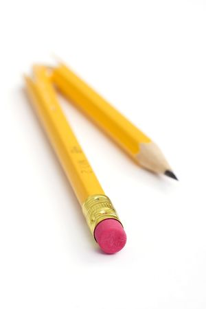 broken yellow pencil on white paper background