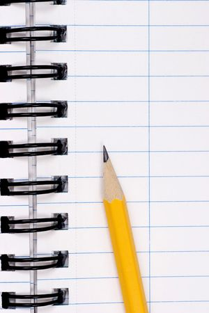 yellow pencil on clean lined notebook Stock Photo - 755219