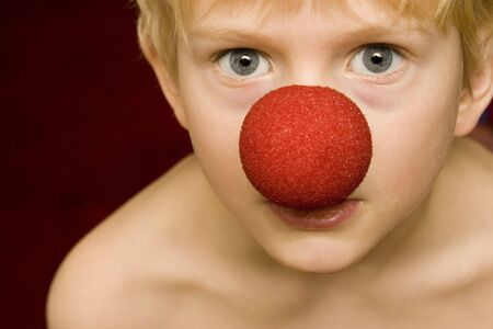 boy with clown nose Stock Photo