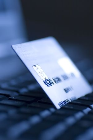 credit card and laptop computer