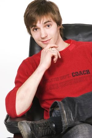 entrepeneur: young man sitting on the chair