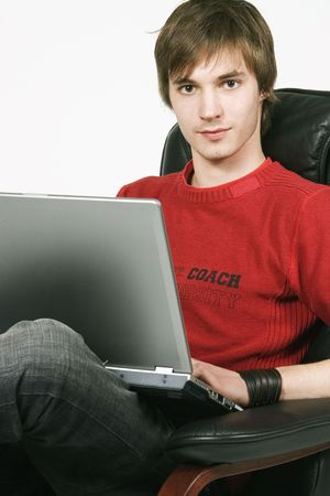 young man working at a laptop computer photo