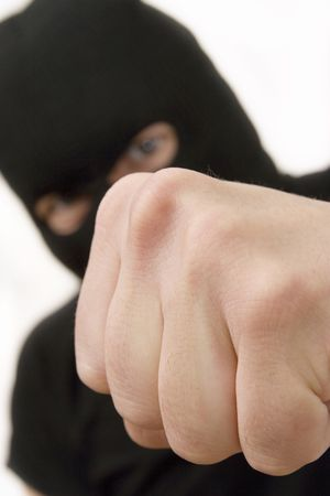 evil criminal wearing military mask and throwing the fist Stock Photo - 1005913