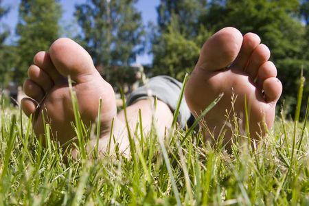 dasiy: feet relaxing on grass (summer time)
