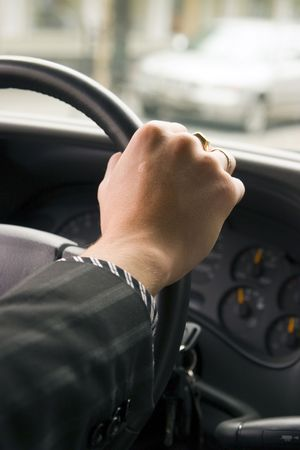 driving a car (hand on the steering wheel) Stock Photo