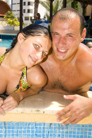 An attractive young couple relaxing by the pool Stock Photo - 1456719