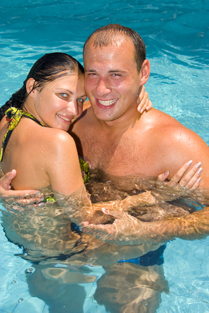 An attractive young couple relaxing by the pool Stock Photo - 1456717