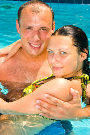 An attractive young couple relaxing by the pool Stock Photo - 1456716