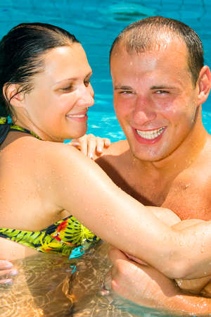 An attractive young couple relaxing by the pool Stock Photo - 1456718
