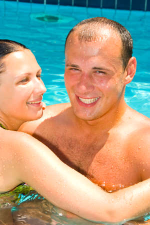 An attractive young couple relaxing by the pool Stock Photo - 1456713