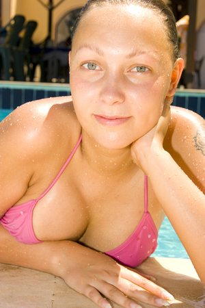 young beautiful girl relaxing by the pool Stock Photo - 1504500