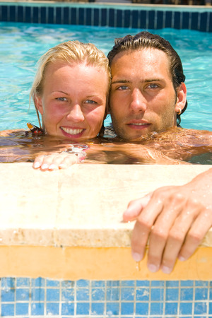 attractive young couple relaxing by the pool Stock Photo - 1518460