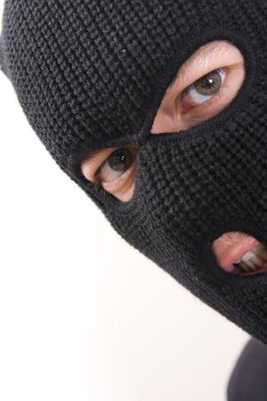 Böse Strafverfahren tragen militärische Maske Standard-Bild - 1648755