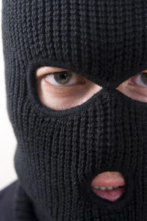 evil criminal wearing military mask