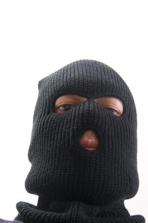 hijacker: criminal malvado que usa la m�scara militar Foto de archivo