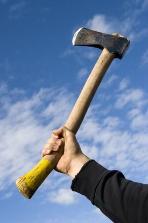 assassinate: hand with an axe on sky background Stock Photo