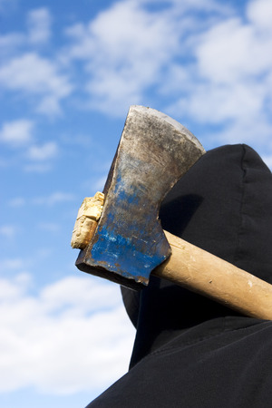 delinquent: man with an axe on sky background