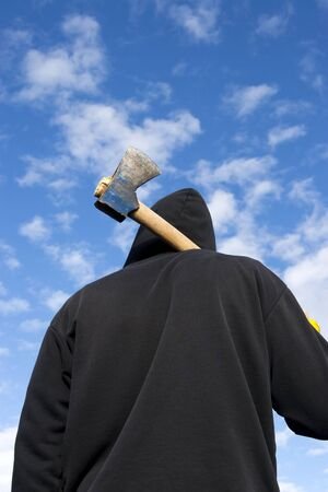 assassinate: man with an axe on sky background