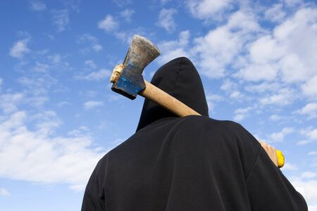 man with an axe on sky background Stock Photo - 1648774