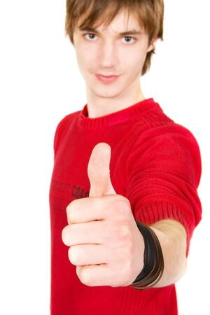 young man with thumbs up on white background Standard-Bild