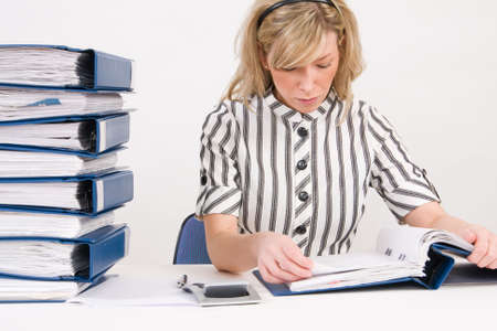 Successful business woman working with documents