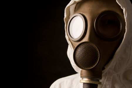 toxins: Person in gas mask on black background