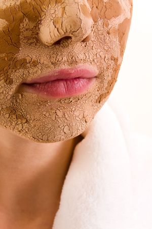 Portrait of young woman with facial mask Stock Photo