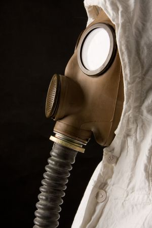 Person in gas mask on dark background