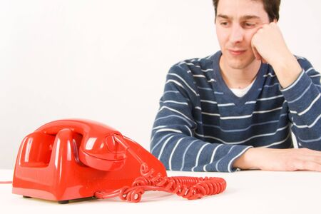 young man waiting for a phone call