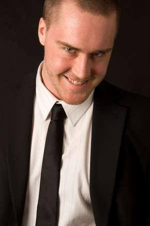 Portrait of a young businessman on dark background Standard-Bild