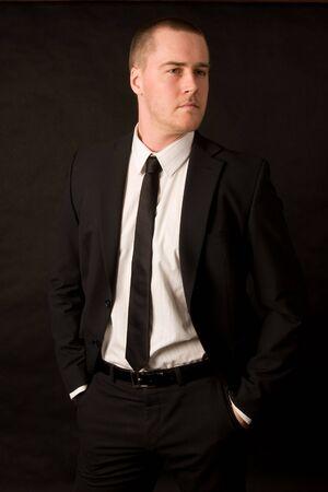 Portrait of a young businessman on black background Standard-Bild