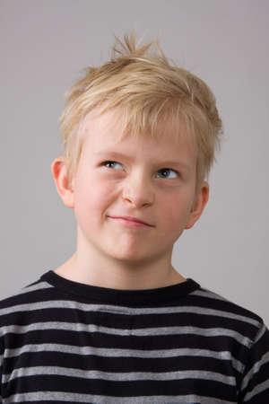 Portrait of a little boy making grimace photo