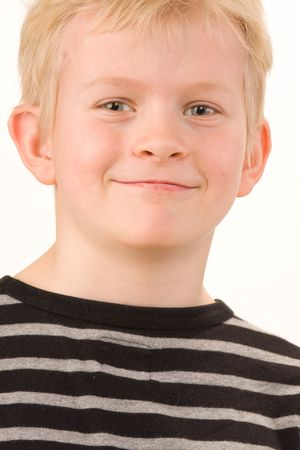 Portrait of a little boy posing on white background photo