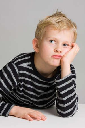 Portrait of a thinking little boy photo