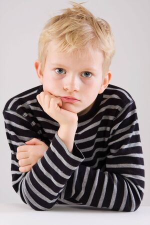 fidgety: Portrait of a thinking little boy Stock Photo