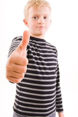 Portrait of a smiling little boy, thumbs up photo