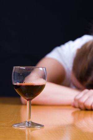 young woman passed out from alcohol photo