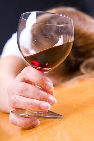 irresponsible: young woman passed out from alcohol