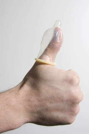 thumbs up, condom on thumb, Stock Photo - 2839420