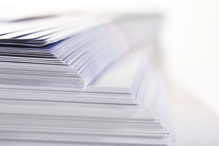 stack of flyers on white background Stock Photo