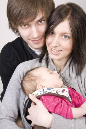 happy young parents with their baby girl