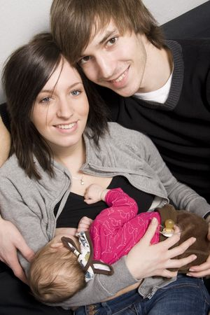 Happy young parents with their baby girl Stock Photo
