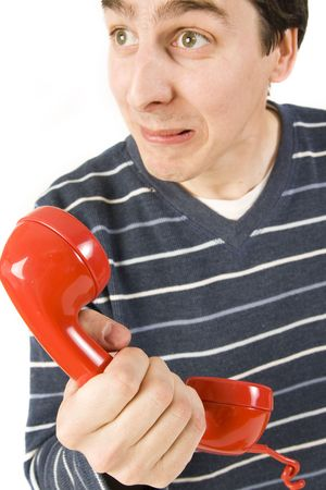 young man holding red telephone receiver photo