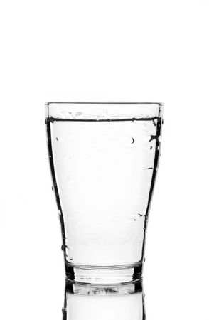 glass of clean water with reflection (white background)