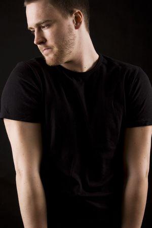young man portrait on black background Standard-Bild