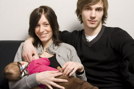 Happy young parents with their baby girl photo