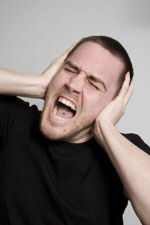 young man having very painful headache