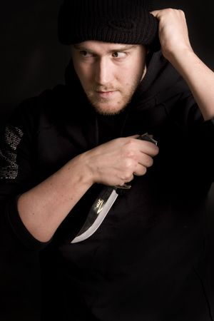 guerrilla: evil criminal with a knife wearing balaclava Stock Photo
