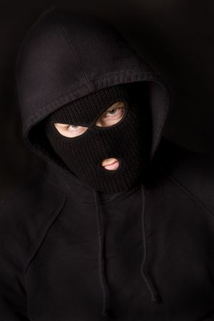 stealer: evil criminal wearing balaclava